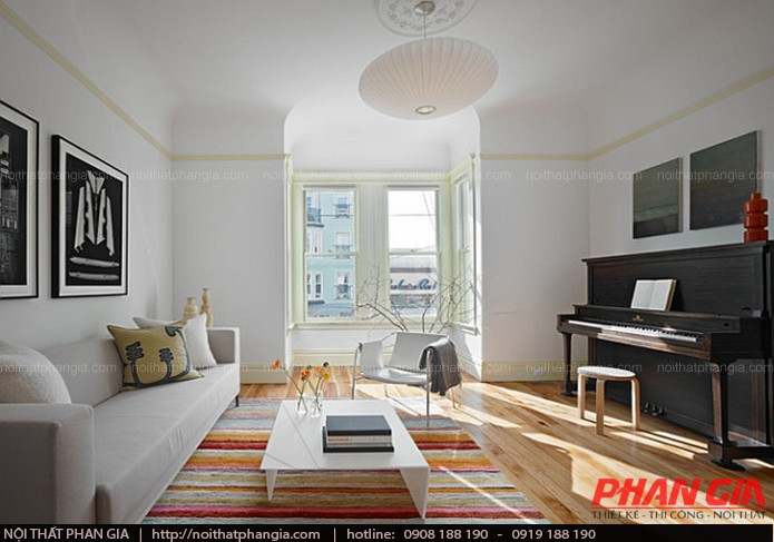 Thiết kế nội thất phòng khách với điểm nhấn tấm thảm đầy màu sắc